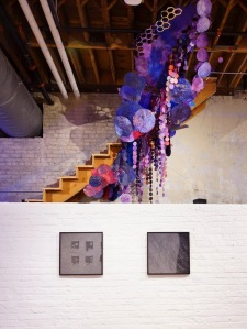 (Installation rising above the vault, along the staircase) hand dyed paper circles varying from three to 14 inches, monoprinting, screenprinting, sewing, cut paper, map tacks 2013