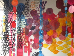 hand dyed paper circles varying from three to 14 inches, monoprinting, screenprinting, sewing, cut paper, map tacks & methyl cellulose Complete installation fills a 12 x 15 feet corner of the gallery space, window included 2013