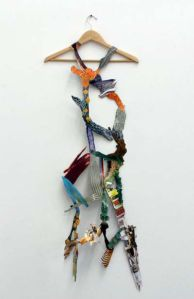 """Fashionably High (Art)"" 2012 Found paper images and wooden clothes hanger. approx. 20"" by 54"""
