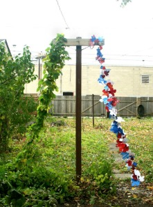 """American 2012 (Pyramid Without a Capstone)"", 2012, Found paper images, wooden laundry pole, cascade hops vine, aluminum wire, and nylon string, sizes variable"