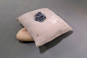 """Digestive Rest,"" Pigmented porcelain, wax and floor pillow, 11 x 33 x 29"", 2012"