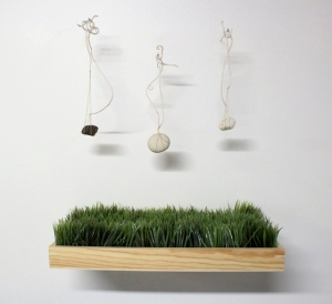 The Weight of Translation, 2014, Porcelain thread, cotton thread, rocks from my collection: gneiss, porcelain, pumice, synthetic grass, wood.