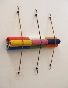 Stacked & Strapped, used paint rollers and bungee cord on wall, dims vary, 2010