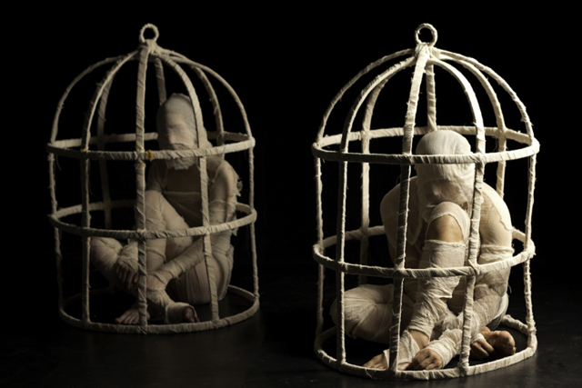 The Body Cage (Your Body Holds You Back) - Installation at UNB Art Centre 2012: Digital photograph, mixed media, and video with original choreography by Julie Scriver and original score by Devon Ross Cages: cotton, plywood, steel, 2011-2012