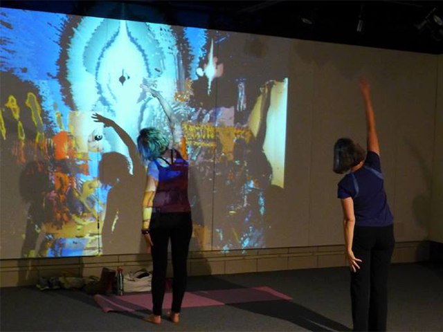 """Mirror Minus"" (Yoga in the Gallery, 5/2/14, Rosewood Art Gallery, Kettering, OH), Interactive installation (video projection and camera), 9'x12' projection, 2014"