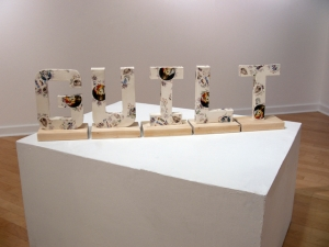 "1)Guilt, 2012, slip cast earthenware and decals, 48"" x 13"" x 6"""