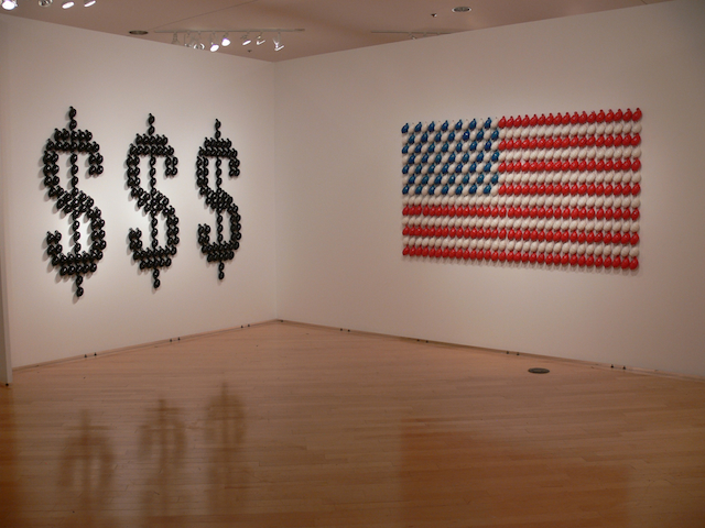 "3)TAMIU Studio Art Faculty Show, Gallery Installation- Greed Stars and Stripes Greed, 2011, slip cast earthenware, 6' 7"" x 5' 7"" x 3""  	Stars and Stripes, 2011, slip cast earthenware, 7' x 5' x 3"""