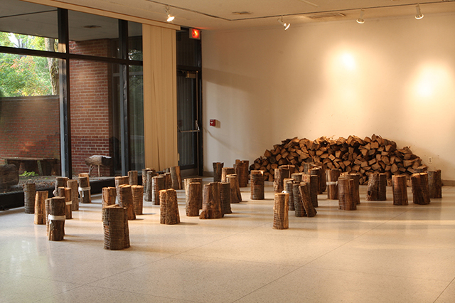 """Woodlot, performance/installation work, ½ cord firewood and string, 8 hours, part of """"8-Hour Projects: Performativity"""" at Allegheny College, Meadville, PA, 2013."""