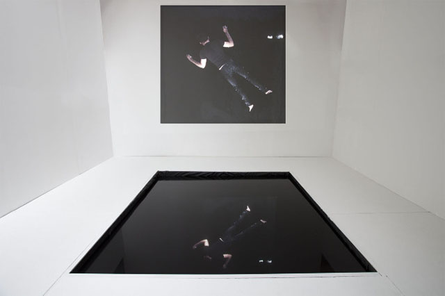 """Repeating Histories"" Multimedia installation consisting of black reflecting pool, performance for the camera, and video projection. 2013"