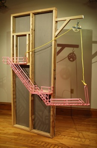 """We ascend each day as heat rising, 2013, wall studs, drywall, polystyrene, screen, pulley, rope, light. Approx. 84"""" x 50"""" x 12"""""""