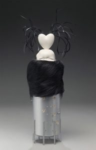 """Love Nest,"" Porcelain, fur muff, swan feathers and plastic, 26"" h x 10"" w x 7"" d, 2009."