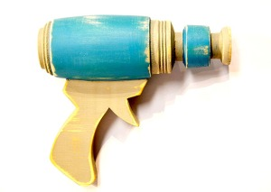 Blue Ray Gun – 2014     1:1 scale prop ray gun made from pine, turned poplar, & paint     approximately 6 x 8 x 3 inches