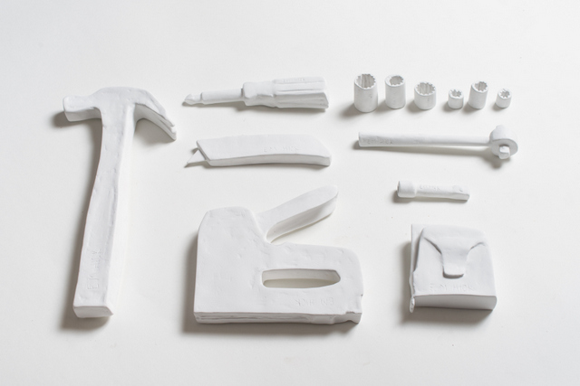 """Hand tools"", 2014, plaster on cardboard, 1.75 by 22 by 14 in. (dimensions variable)"