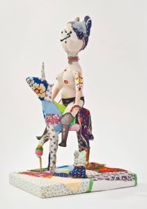 The Mistress, her Baby and the Ejaculating Unicorn 2014 | 41 x 64 x 30 cm | Wood, found Objects, Recycled textiles, Pre- owned Toy parts, Fibre Stuffing *Farsi text Translation: Affection (front), And the rest of the stories (back)