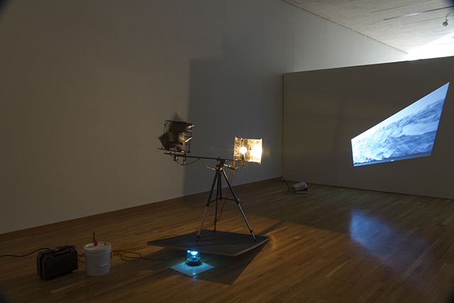 """Liminal Observation System 1.0, 2013 mixed media with analog timer, DC motor, HD video projection variable to 40""""high"""