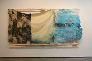"""Mathematical Irradiation 2014 130"""" (l) x 70"""" (h). Extend 4 inches from wall. Carved wooden support, paper, linen and cotton fabric, thread, string, ink, wax, various dyes and pigments, sand, cornmeal, table salt, aluminum potassium sulfate."""