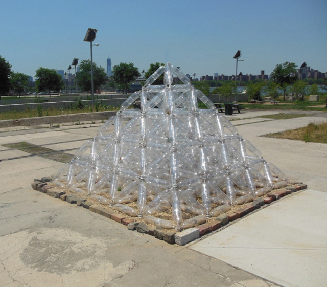 "​​Plastic Bottle Pyramid, Collaboration with Sungjin Oh, plastic bottles, caps, gravel, 7' 6"" x 11' x 11', 2012"