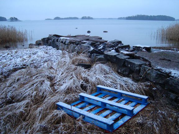 Pallet Series (project documentation, dimensions variable, 2010): Hand painted shipping pallet abandoned off Helsinki coast after full delivery circuit 2007-12.