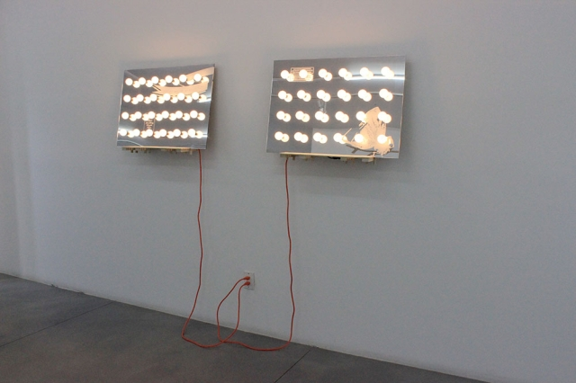vs. Vanitas mirrored acrylic, light bulbs, poplar, electrical cords 24″h x 72″w x 12″d 2014