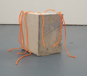 "burial ground for parrots, concrete and neon bungee cord, approx. 10""x 12""x 7-1/2,"" 2015"