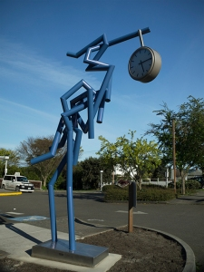 title:  Great Blue media:  powder coated steel, stainless steel, and clock dimensions:  13'H x 8'W x 3'D year:  2015