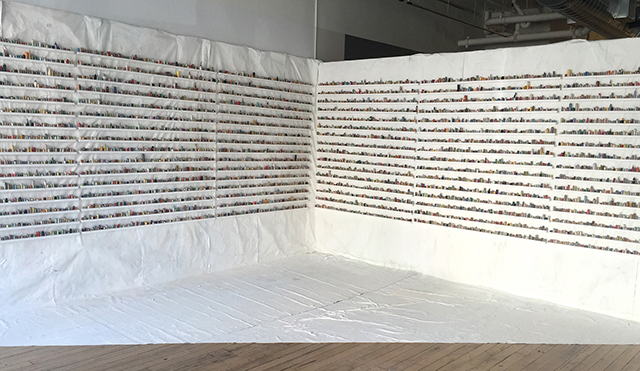 """the sculptural painting: number two"" rolled up paintskins on wooden shelves, 8'x15'10', 2015"