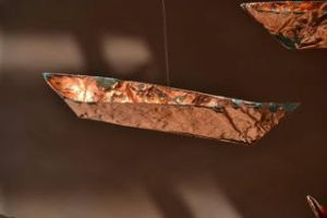 Paper, paint, thread and copper leaf, 1000 origami canoes 12' x 40' ( 3.65 x 12.1 metres ) installation 2015